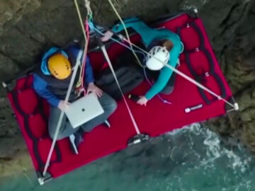 Call centre worker completes shift while dangling off side of 50ft cliff face